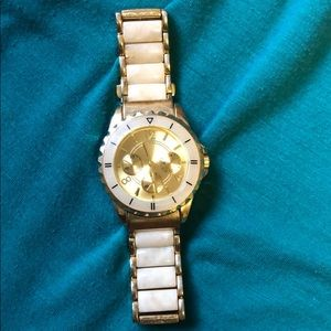 Gold watch with white tortoise shell detail